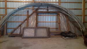 By the end of March, I had already found a greenhouse frame for sale. Breck, Dad and I went to pick it up. I can't wait to get it up at our new place. At the same time, Scott was working on framing in our pole barn.