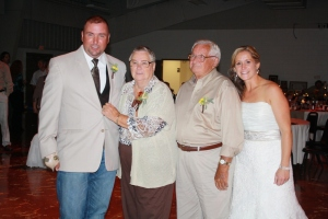 Sept. 22, 2012. At our wedding, right after the anniversary dance, which they won. It's one of the only pictures I have of all 4 of us together.